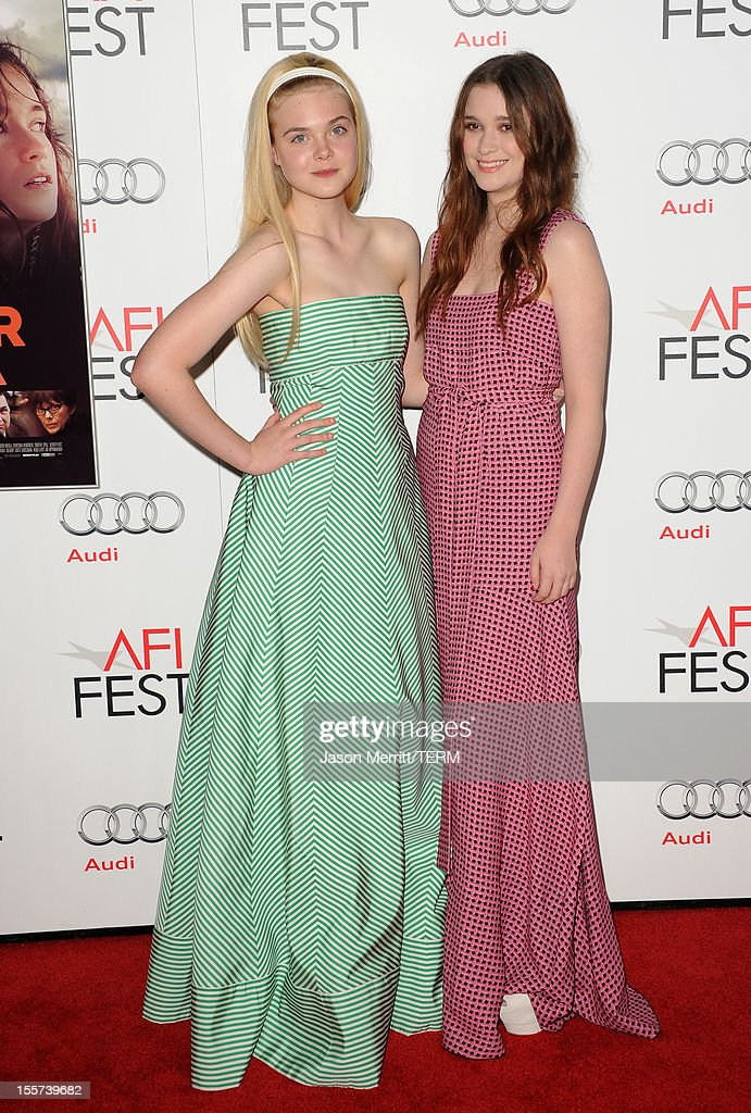 Actresses <a gi-track='captionPersonalityLinkClicked' href=/galleries/search?phrase=Elle+Fanning&family=editorial&specificpeople=2189940 ng-click='$event.stopPropagation()'>Elle Fanning</a> (L) and Alice Englert arrive at the 'Ginger And Rosa' special screening during AFI Fest 2012 presented by Audi at Grauman's Chinese Theatre on November 7, 2012 in Hollywood, California.