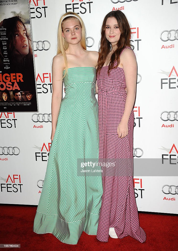 Actresses Elle Fanning and Alice Englert attend the 2012 AFI Fest premiere of 'Ginger & Rosa' at Grauman's Chinese Theatre on November 7, 2012 in Hollywood, California.