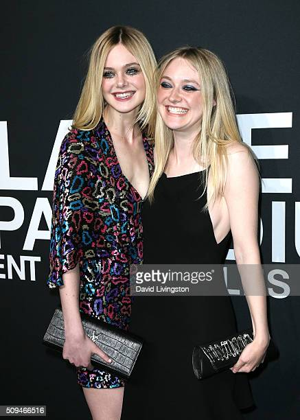 Actresses Elle Fanning and Dakota Fanning attend Saint Laurent at Hollywood Palladium on February 10 2016 in Los Angeles California