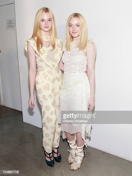 Actresses Elle Fanning and Dakota Fanning attend the Rodarte Spring 2012 fashion show at Pace Gallery during MercedesBenz Fashion Week on September...