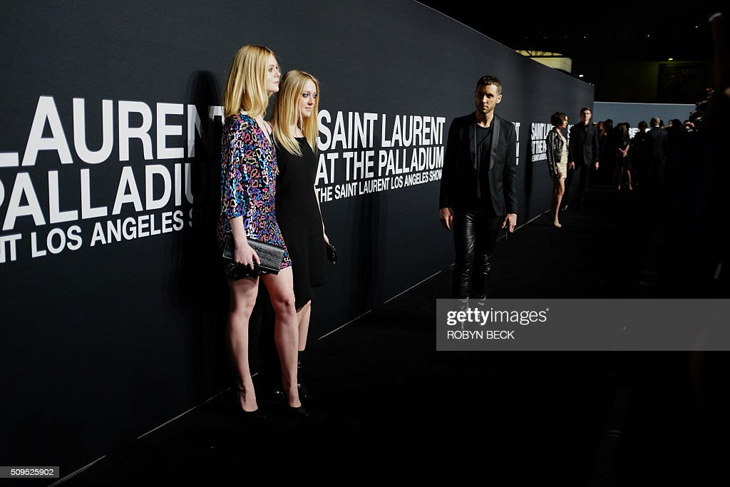 Actresses Elle Fanning and Dakota Fanning attend the Saint Laurent men's fall line and the first part of its women's collection fashion show at the Paladium, in Hollywood, California, February 10, 2016. / AFP / ROBYN BECK