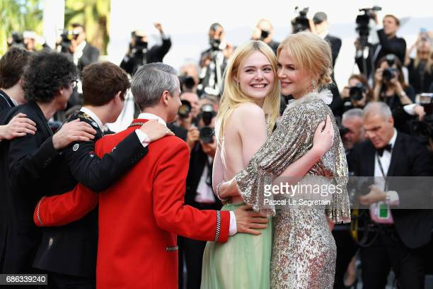 Actresses Elle Fanning and Nicole Kidman depart after the 'How To Talk To Girls At Parties' screening during the 70th annual Cannes Film Festival at...