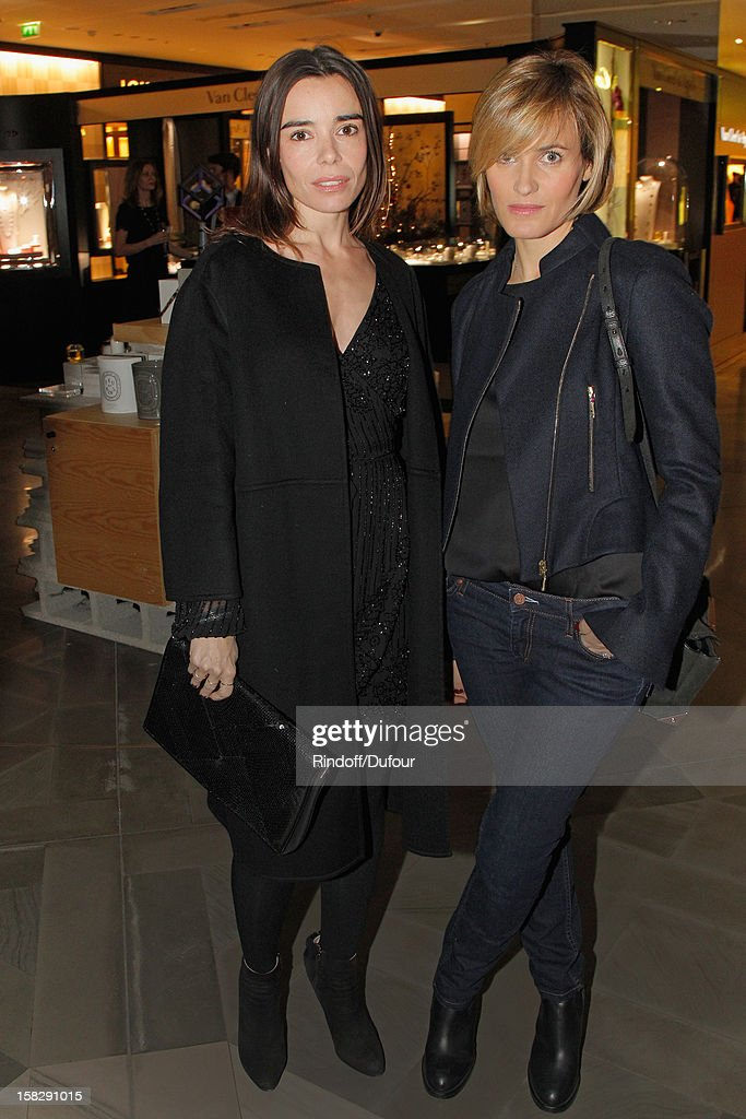 Actresses <a gi-track='captionPersonalityLinkClicked' href=/galleries/search?phrase=Elodie+Bouchez&family=editorial&specificpeople=228476 ng-click='$event.stopPropagation()'>Elodie Bouchez</a> (L) and <a gi-track='captionPersonalityLinkClicked' href=/galleries/search?phrase=Judith+Godreche&family=editorial&specificpeople=624126 ng-click='$event.stopPropagation()'>Judith Godreche</a> attend the Galeries Lafayette 100th Anniversary Bal on December 12, 2012 in Paris, France.