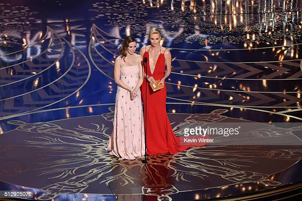 Actresses Emily Blunt and Charlize Theron speak onstage during the 88th Annual Academy Awards at the Dolby Theatre on February 28 2016 in Hollywood...