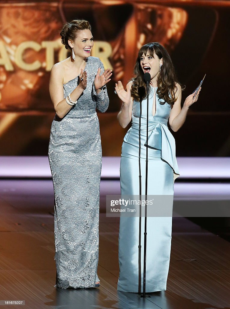 Actresses <a gi-track='captionPersonalityLinkClicked' href=/galleries/search?phrase=Emily+Deschanel&family=editorial&specificpeople=240264 ng-click='$event.stopPropagation()'>Emily Deschanel</a> (L) and <a gi-track='captionPersonalityLinkClicked' href=/galleries/search?phrase=Zooey+Deschanel&family=editorial&specificpeople=202927 ng-click='$event.stopPropagation()'>Zooey Deschanel</a> speak onstage during the 65th Annual Primetime Emmy Awards held at Nokia Theatre L.A. Live on September 22, 2013 in Los Angeles, California.