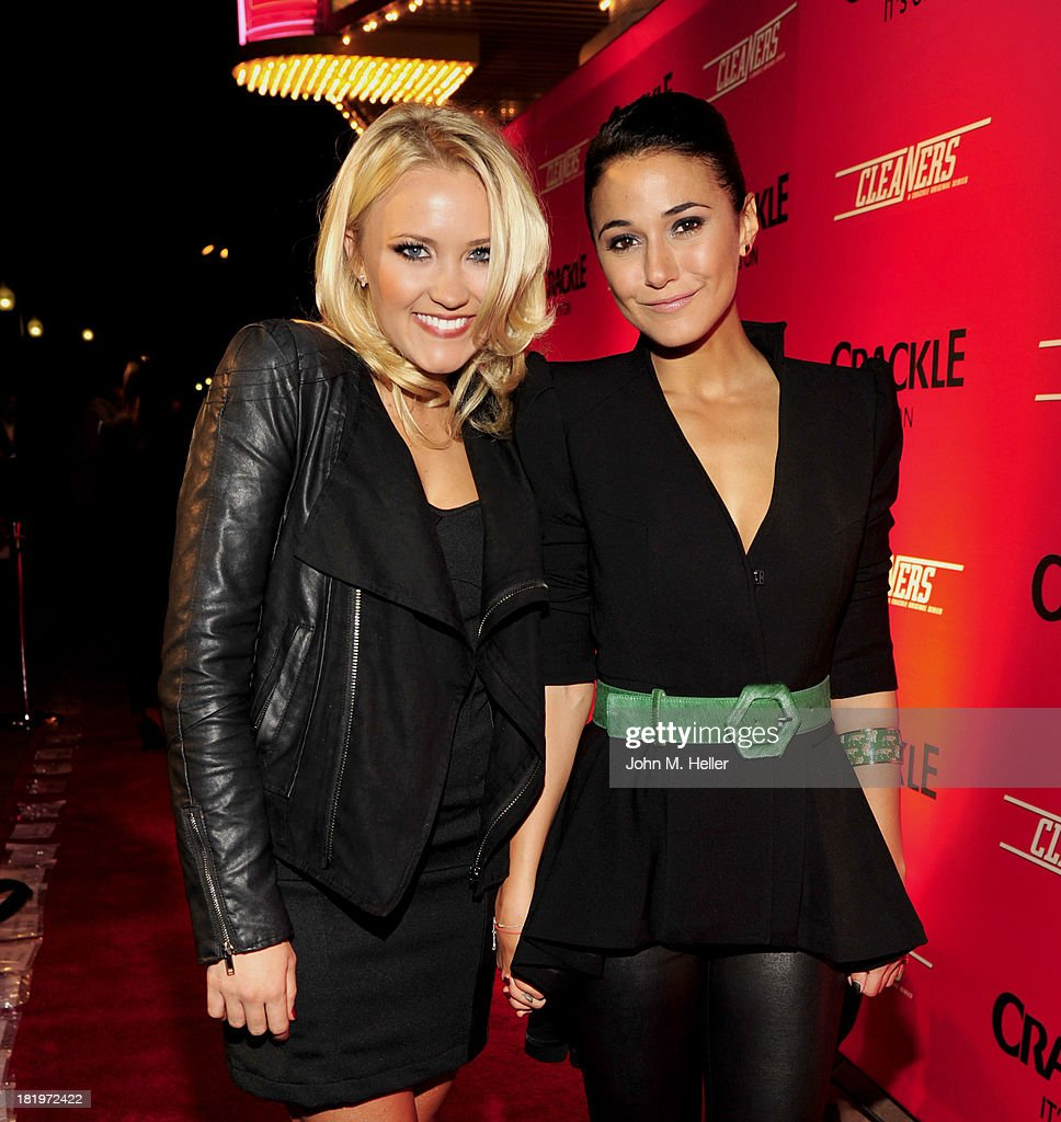 Actresses <a gi-track='captionPersonalityLinkClicked' href=/galleries/search?phrase=Emily+Osment&family=editorial&specificpeople=873997 ng-click='$event.stopPropagation()'>Emily Osment</a> and Emannuelle Chriqui attend the premiere of Crackle's new original digital series 'Cleaners' at the Cary Grant Theater on the Sony Pictures Studio lot on September 26, 2013 in Culver City, California.