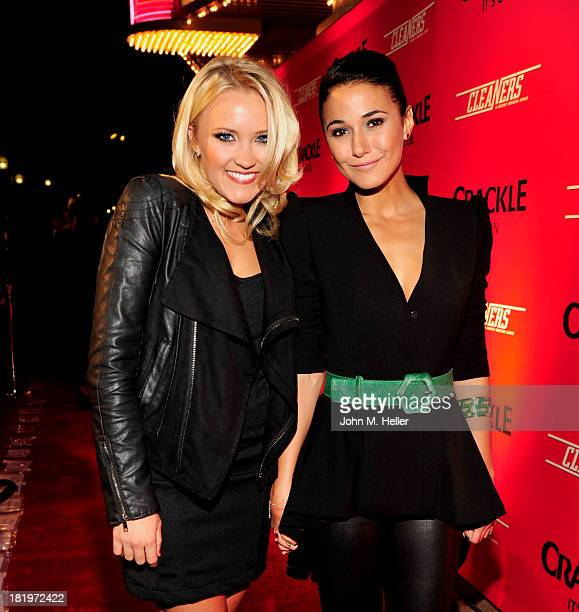 Actresses Emily Osment and Emannuelle Chriqui attend the premiere of Crackle's new original digital series 'Cleaners' at the Cary Grant Theater on...