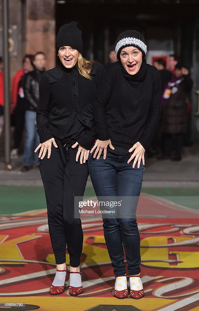 Actresses Emily Padgett and Erin Davie take part in the 88th Annual Macy's Thanksgiving Day Parade day 2 rehearsals on November 25, 2014 in New York City.