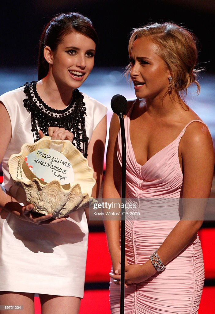 Actresses Emma Roberts (L) and Hayden Panettiere speak onstage during the 2009 Teen Choice Awards held at Gibson Amphitheatre on August 9, 2009 in Universal City, California.