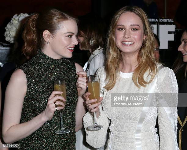 Actresses Emma Stone and Brie Larson attend the 10th Annual Women in Film PreOscar Cocktail Party presented by Max Mara and BMW at the Nightingale...