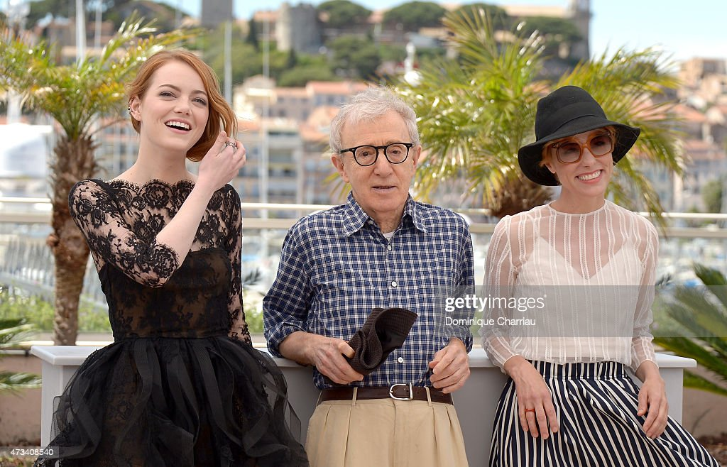 Actresses Emma Stone (L) and Parker Posey (R) with director Woody Allen (C) attend the 'Irrational Man' Photocall during the 68th annual Cannes Film Festival on May 15, 2015 in Cannes, France.