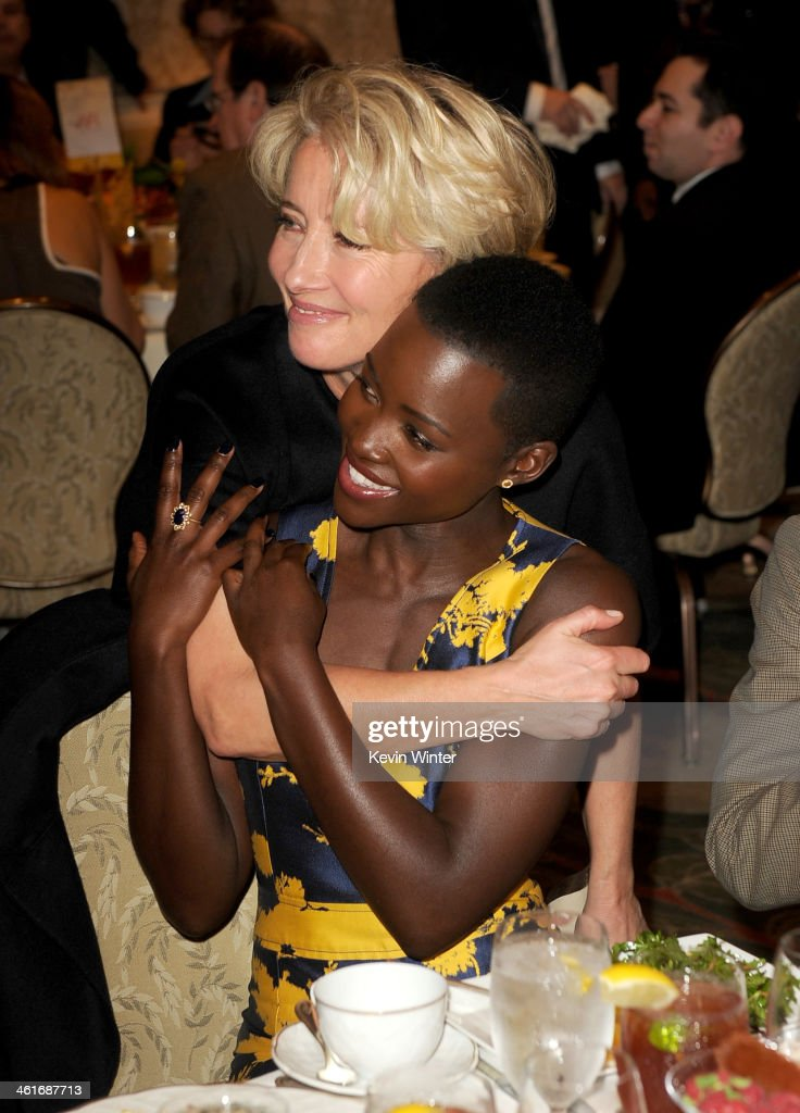 Actresses <a gi-track='captionPersonalityLinkClicked' href=/galleries/search?phrase=Emma+Thompson&family=editorial&specificpeople=202848 ng-click='$event.stopPropagation()'>Emma Thompson</a> (L) and <a gi-track='captionPersonalityLinkClicked' href=/galleries/search?phrase=Lupita+Nyong%27o&family=editorial&specificpeople=10961876 ng-click='$event.stopPropagation()'>Lupita Nyong'o</a> attend the 14th annual AFI Awards Luncheon at the Four Seasons Hotel Beverly Hills on January 10, 2014 in Beverly Hills, California.