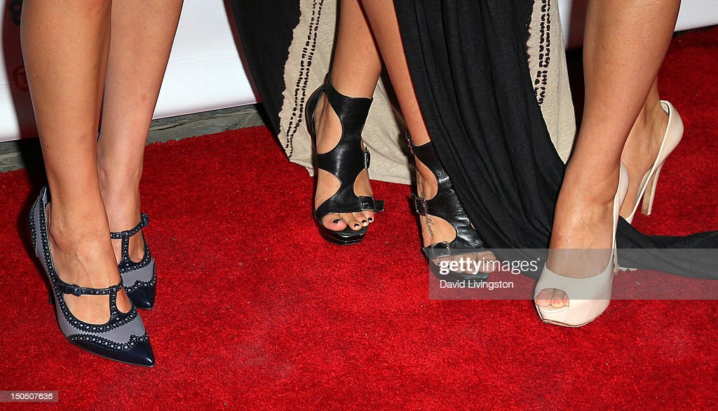 Actresses Eva Amurri Martino, Serinda Swan and Shay Mitchell (shoe detail) attend Friends to Mankind's 2nd annual 18 For 18 charity event and fundraiser 'The Jump' benefitting the Somaly Mam Foundation at Lexington Social House on August 19, 2012 in Hollywood, California.
