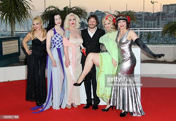Actresses Evie Lovell Mimi Le Meaux winner of the award for Best Director Mathieu Amalric Dirty Martini and Kitten on the Keys attend the Palme d'Or...