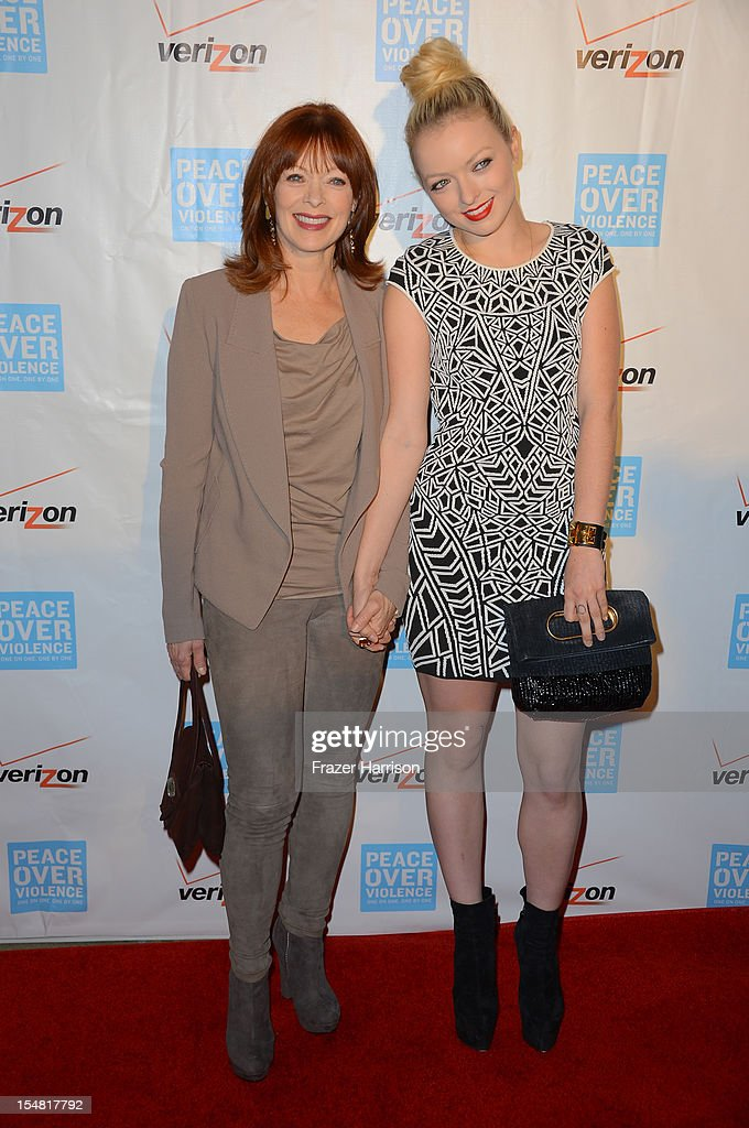 Actresses <a gi-track='captionPersonalityLinkClicked' href=/galleries/search?phrase=Frances+Fisher&family=editorial&specificpeople=211520 ng-click='$event.stopPropagation()'>Frances Fisher</a> (L) and Francesca Eastwood arrive at the 41st Annual Peace Over Violence Humanitarian Awards held at Beverly Hills Hotel on October 26, 2012 in Beverly Hills, California.