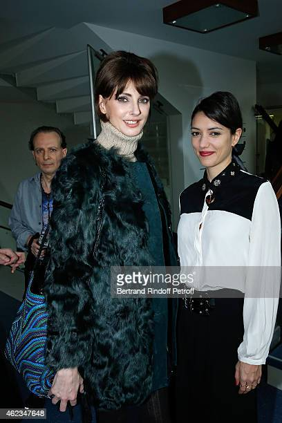 Actresses Frederique Bel and Vanessa Guide attends the Stephane Rolland show as part of Paris Fashion Week Haute Couture Spring/Summer 2015 on...
