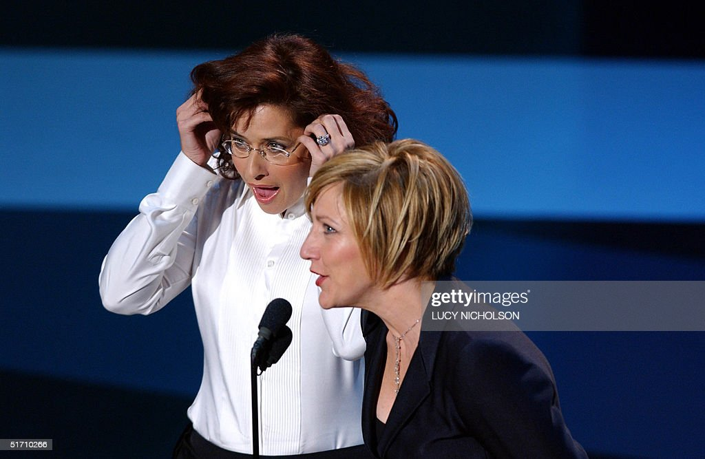 Actresses from the tv show 'The Sopranos' Edie Falco (R) and Lorraine Bracco present the Made for Television Movie award during the 53rd Emmy Awards show in Los Angeles, California, 04 November 2001. After two postponements attributed to the war on terrorism the awards show is finally being held at a small venue at Shubert Theatre. AFP PHOTO/Lucy NICHOLSON