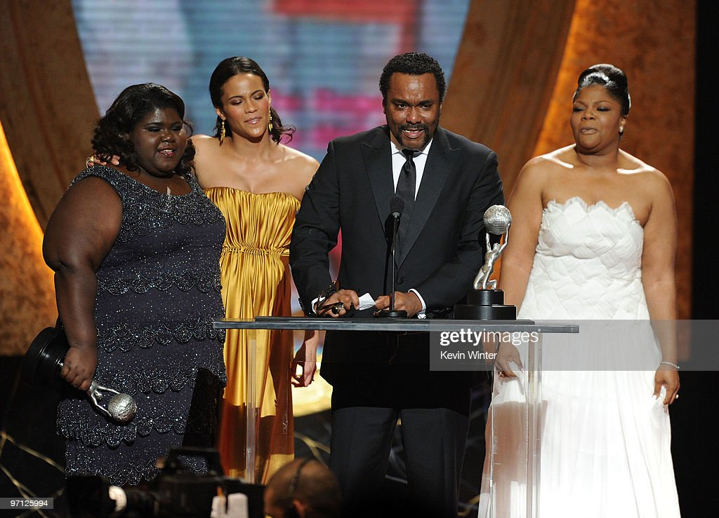Actresses <a gi-track='captionPersonalityLinkClicked' href=/galleries/search?phrase=Gabourey+Sidibe&family=editorial&specificpeople=5667783 ng-click='$event.stopPropagation()'>Gabourey Sidibe</a>, <a gi-track='captionPersonalityLinkClicked' href=/galleries/search?phrase=Paula+Patton&family=editorial&specificpeople=752812 ng-click='$event.stopPropagation()'>Paula Patton</a>, director <a gi-track='captionPersonalityLinkClicked' href=/galleries/search?phrase=Lee+Daniels&family=editorial&specificpeople=209078 ng-click='$event.stopPropagation()'>Lee Daniels</a>, and actress <a gi-track='captionPersonalityLinkClicked' href=/galleries/search?phrase=Mo%27Nique&family=editorial&specificpeople=213364 ng-click='$event.stopPropagation()'>Mo'Nique</a> onstage during the 41st NAACP Image awards held at The Shrine Auditorium on February 26, 2010 in Los Angeles, California.