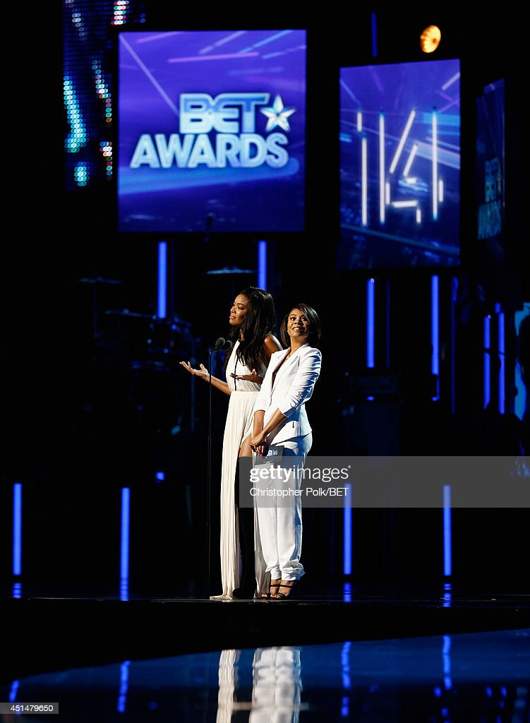 Actresses Gabrielle Union (L) and Regina Hall onstage during the BET AWARDS '14 at Nokia Theatre L.A. LIVE on June 29, 2014 in Los Angeles, California.