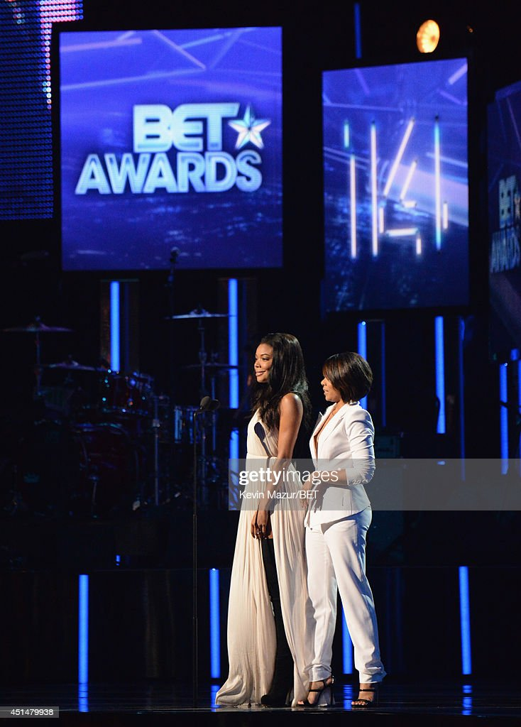 Actresses Gabrielle Union and Regina Hall speak onstage during the BET AWARDS '14 at Nokia Theatre L.A. LIVE on June 29, 2014 in Los Angeles, California.