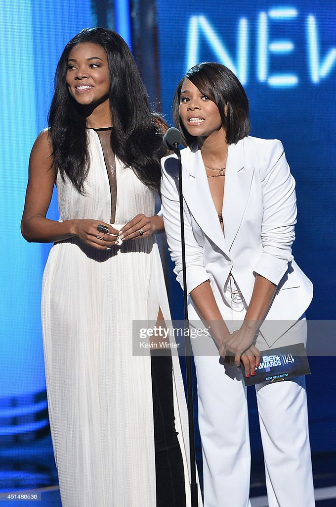 Actresses Gabrielle Union (L) and Regina Hall speak onstage during the BET AWARDS '14 at Nokia Theatre L.A. LIVE on June 29, 2014 in Los Angeles, California.