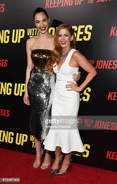 Actresses Gal Gadot and Isla Fisher arrive at the premiere of 20th Century Fox's 'Keeping Up With The Joneses' at Fox Studios on October 8 2016 in...