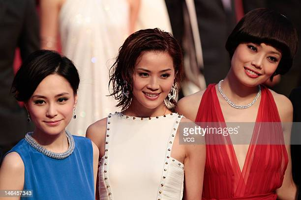 Actresses Gillian Chung Charlene Choi and Joey Yung arrive at the red carpet during the opening ceremony for the 15th Shanghai International Film...