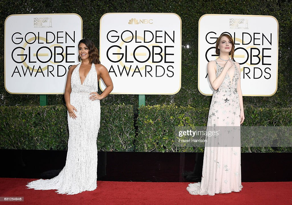 actresses-gina-rodriguez-and-emma-stone-attend-the-74th-annual-golden-picture-id631254946