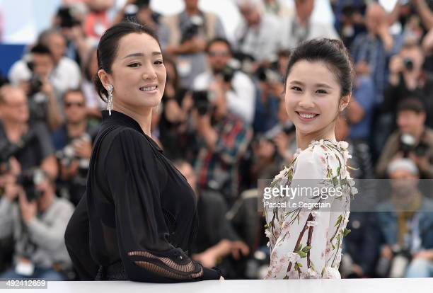 Actresses Gong Li and Huiwen Zhang attend the 'Coming Home' photocall at the 67th Annual Cannes Film Festival on May 20 2014 in Cannes France