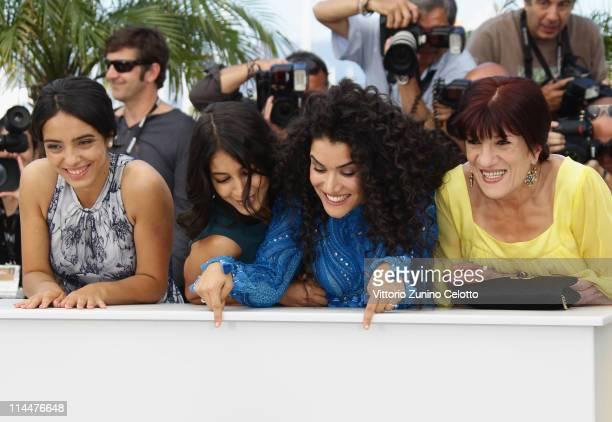 Actresses Hafsia Herzi Leila Bekhti Sabrina Ouazani and Biyouna attend the 'La Source Des Femmes' Photocall at Palais des Festivals during 64th...