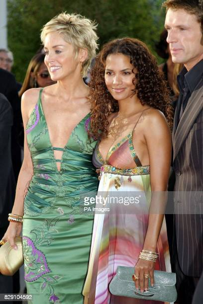Actresses Halle Berry and Sharon Stone arrive for the premiere of their latest film Catwoman held at the Cinerama Dome Theatre Los Angeles USA