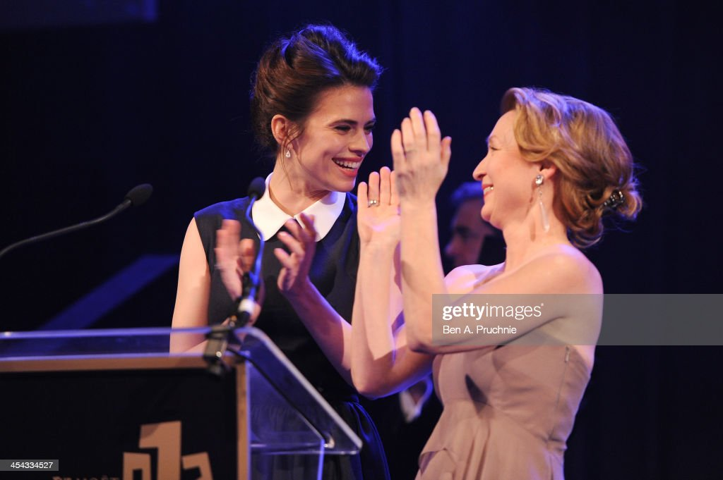 Actresses <a gi-track='captionPersonalityLinkClicked' href=/galleries/search?phrase=Hayley+Atwell&family=editorial&specificpeople=2331262 ng-click='$event.stopPropagation()'>Hayley Atwell</a> (L) and <a gi-track='captionPersonalityLinkClicked' href=/galleries/search?phrase=Lesley+Manville&family=editorial&specificpeople=2826107 ng-click='$event.stopPropagation()'>Lesley Manville</a> present the award for Best Actor as they attend the ceremony for the Moet British Independent Film Awards at Old Billingsgate Market on December 8, 2013 in London, England.