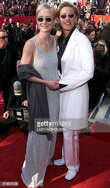 Actresses Helen Degeneres and partner Anne Heche pose for photographers upon their arrival at the Dorothy Chandler Pavilion in Los Angeles CA for the...