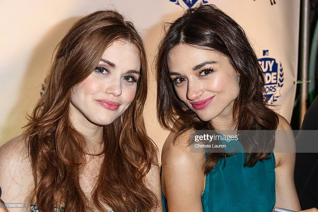 Actresses Holland Roden (L) and Crystal Reed attend MTV2 Party in The Park at Comic-con International 2013 at PETCO Park on July 18, 2013 in San Diego, California.