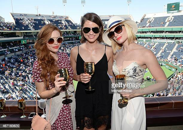 Actresses Holland Roden Shelley Hennig and Beth Behrs visit The Moet and Chandon Suite at the 2015 BNP Paribas Open on March 21 2015 in Indian Wells...