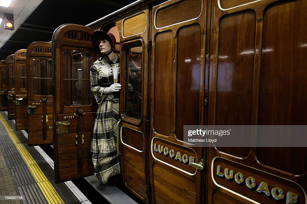 Actresses in period costume pose by the first class carriages pulled by a restored steam engine built in 1898, known as Met Locomotive No. 1, after it arrives at Moorgate station in a recreation of the first London Underground journey on January 13, 2013 in London, England. The London Underground celebrates its 150th birthday this month, the Metropolitan line being the first stretch between Paddington and Farringdon stations.