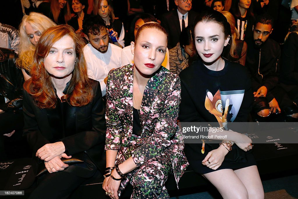 Actresses <a gi-track='captionPersonalityLinkClicked' href=/galleries/search?phrase=Isabelle+Huppert&family=editorial&specificpeople=662796 ng-click='$event.stopPropagation()'>Isabelle Huppert</a>, <a gi-track='captionPersonalityLinkClicked' href=/galleries/search?phrase=Noomi+Rapace&family=editorial&specificpeople=4522889 ng-click='$event.stopPropagation()'>Noomi Rapace</a> and <a gi-track='captionPersonalityLinkClicked' href=/galleries/search?phrase=Lily+Collins&family=editorial&specificpeople=3520243 ng-click='$event.stopPropagation()'>Lily Collins</a> attend Givenchy show as part of the Paris Fashion Week Womenswear Spring/Summer 2014, held at 'la Halle Freyssinet' on September 29, 2013 in Paris, France.