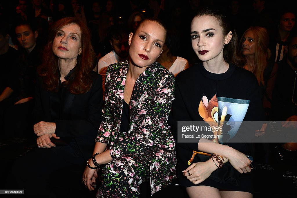 Actresses Isabelle Hupert, <a gi-track='captionPersonalityLinkClicked' href=/galleries/search?phrase=Noomi+Rapace&family=editorial&specificpeople=4522889 ng-click='$event.stopPropagation()'>Noomi Rapace</a> and <a gi-track='captionPersonalityLinkClicked' href=/galleries/search?phrase=Lily+Collins&family=editorial&specificpeople=3520243 ng-click='$event.stopPropagation()'>Lily Collins</a> attend the Givenchy show as part of the Paris Fashion Week Womenswear Spring/Summer 2014 on September 29, 2013 in Paris, France.