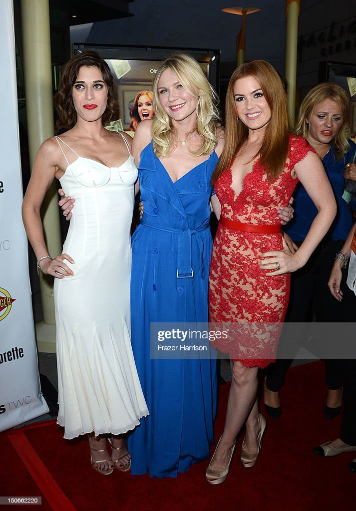 Actresses Isla Fisher, Kirsten Dunst, Lizzy Caplan arrive at the premiere of RADiUS-TWC's 'Bachelorette' at ArcLight Cinemas on August 23, 2012 in Hollywood, California.