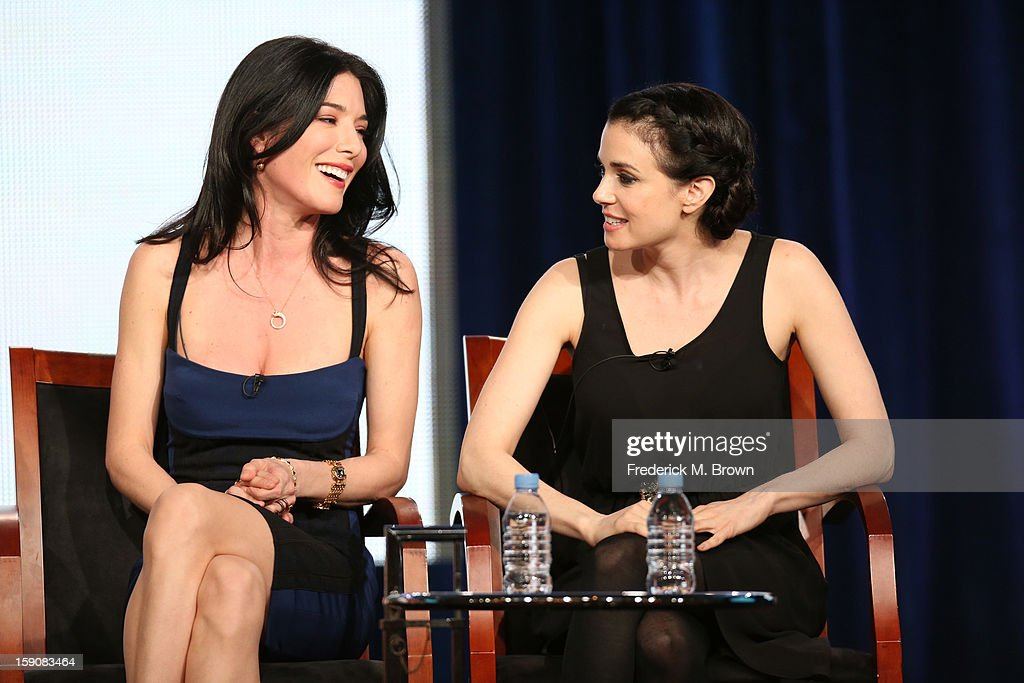 Actresses Jaime Murray (L) and Mia Kirshner speak onstage at the 'Defiance' panel discussion during the Syfy portion of the 2013 Winter TCA Tour- Day 4 at the Langham Hotel on January 7, 2013 in Pasadena, California.
