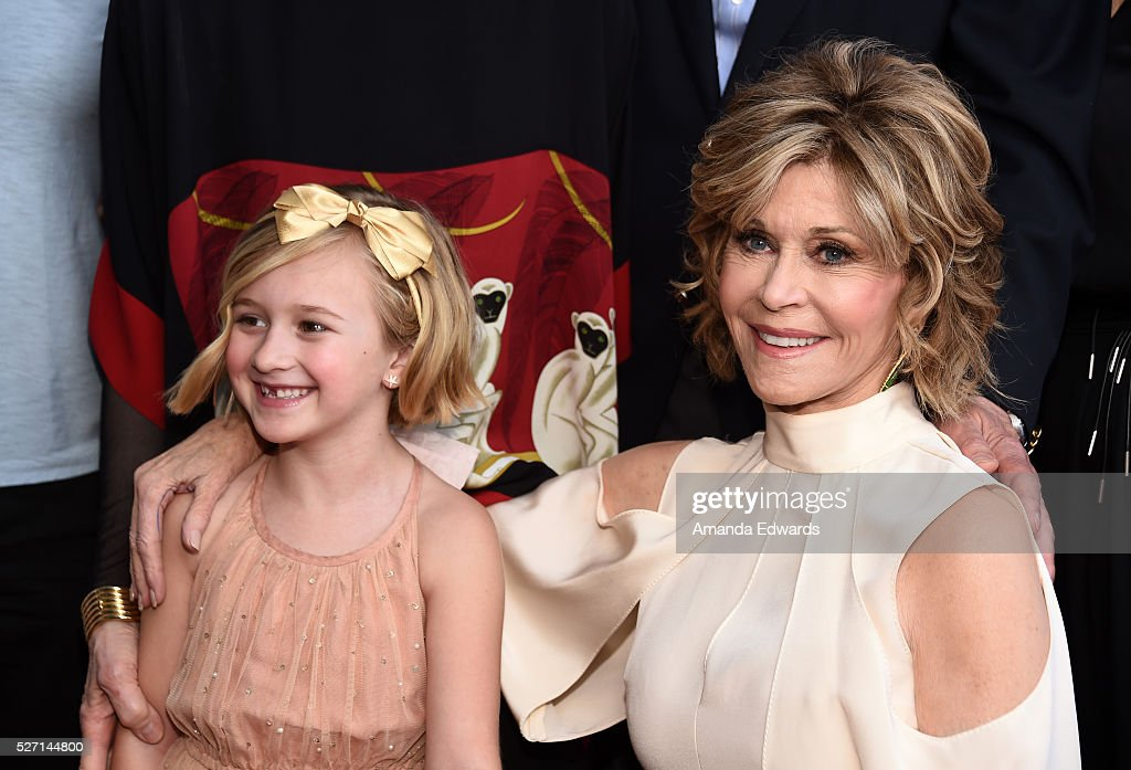 Actresses Jane Fonda (R) and Willa Miel Pogue arrive at the Netflix Original Series 'Grace & Frankie' Season 2 premiere at the Harmony Gold Theater on May 1, 2016 in Los Angeles, California.