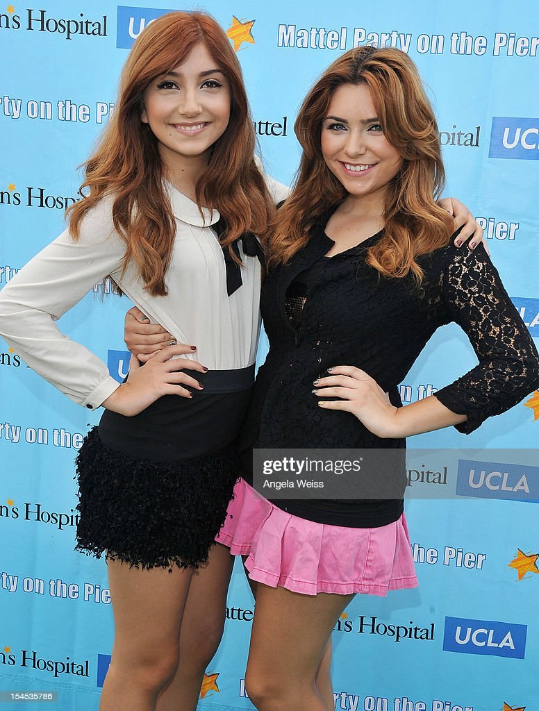 Actresses Jennessa and Julianna Rose arrive to the 'Mattel Party on the Pier' benefiting Mattel Children's Hospital UCLA at Pacific Park on the Santa Monica Pier on October 21, 2012 in Santa Monica, California.