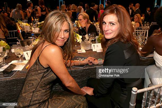Actresses Jennifer Aniston and Julia Roberts attend TNT's 21st Annual Screen Actors Guild Awards at The Shrine Auditorium on January 25 2015 in Los...