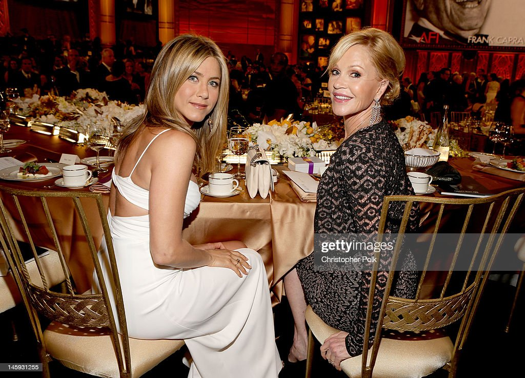 Actresses <a gi-track='captionPersonalityLinkClicked' href=/galleries/search?phrase=Jennifer+Aniston&family=editorial&specificpeople=202048 ng-click='$event.stopPropagation()'>Jennifer Aniston</a> (L) and <a gi-track='captionPersonalityLinkClicked' href=/galleries/search?phrase=Melanie+Griffith&family=editorial&specificpeople=171682 ng-click='$event.stopPropagation()'>Melanie Griffith</a> attend the 40th AFI Life Achievement Award honoring Shirley MacLaine held at Sony Pictures Studios on June 7, 2012 in Culver City, California. The AFI Life Achievement Award tribute to Shirley MacLaine will premiere on TV Land on Saturday, June 24 at 9PM ET/PST.