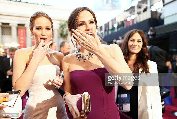 Actresses Jennifer Lawrence and Jennifer Garner arrive at the Oscars held at Hollywood Highland Center on February 24 2013 in Hollywood California
