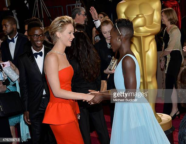 Actresses Jennifer Lawrence and Lupita Nyong'o attend the Oscars held at Hollywood Highland Center on March 2 2014 in Hollywood California