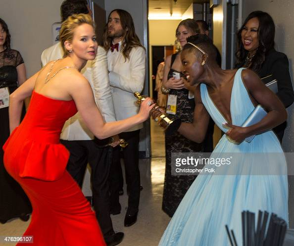 Actresses Jennifer Lawrence and Lupita Nyong'o backstage during the Oscars held at Dolby Theatre on March 2 2014 in Hollywood California