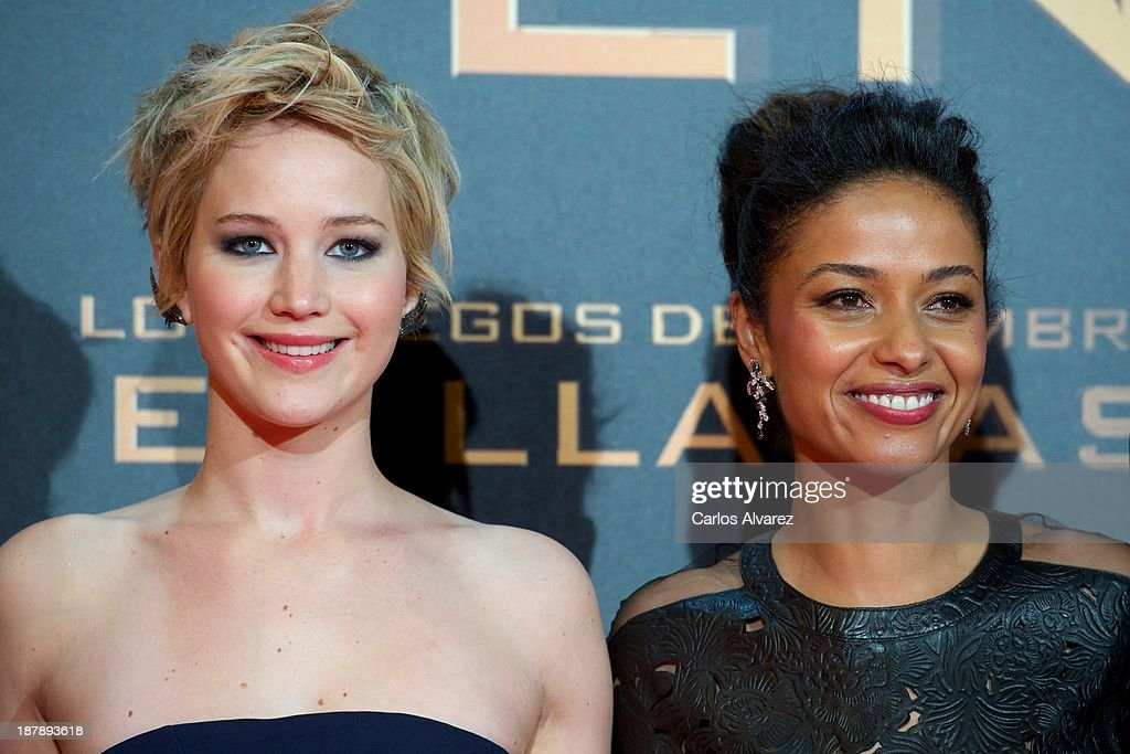Actresses <a gi-track='captionPersonalityLinkClicked' href=/galleries/search?phrase=Jennifer+Lawrence&family=editorial&specificpeople=1596040 ng-click='$event.stopPropagation()'>Jennifer Lawrence</a> (L) and <a gi-track='captionPersonalityLinkClicked' href=/galleries/search?phrase=Meta+Golding&family=editorial&specificpeople=741043 ng-click='$event.stopPropagation()'>Meta Golding</a> (R) attend the Spanish premiere of the film 'The Hunger Games - Catching Fire' (Los Juegos Del Hambre: En Llamas) at the Callao cinema on November 13, 2013 in Madrid, Spain.