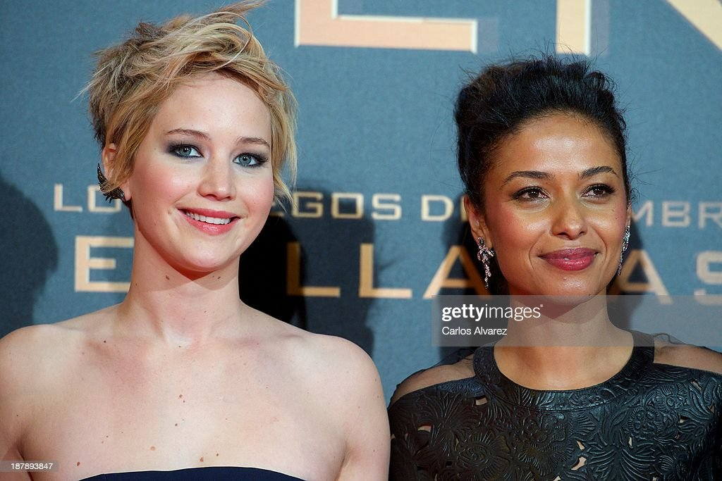 Actresses Jennifer Lawrence (L) and Meta Golding (R) attend the Spanish premiere of the film 'The Hunger Games - Catching Fire' (Los Juegos Del Hambre: En Llamas) at the Callao cinema on November 13, 2013 in Madrid, Spain.
