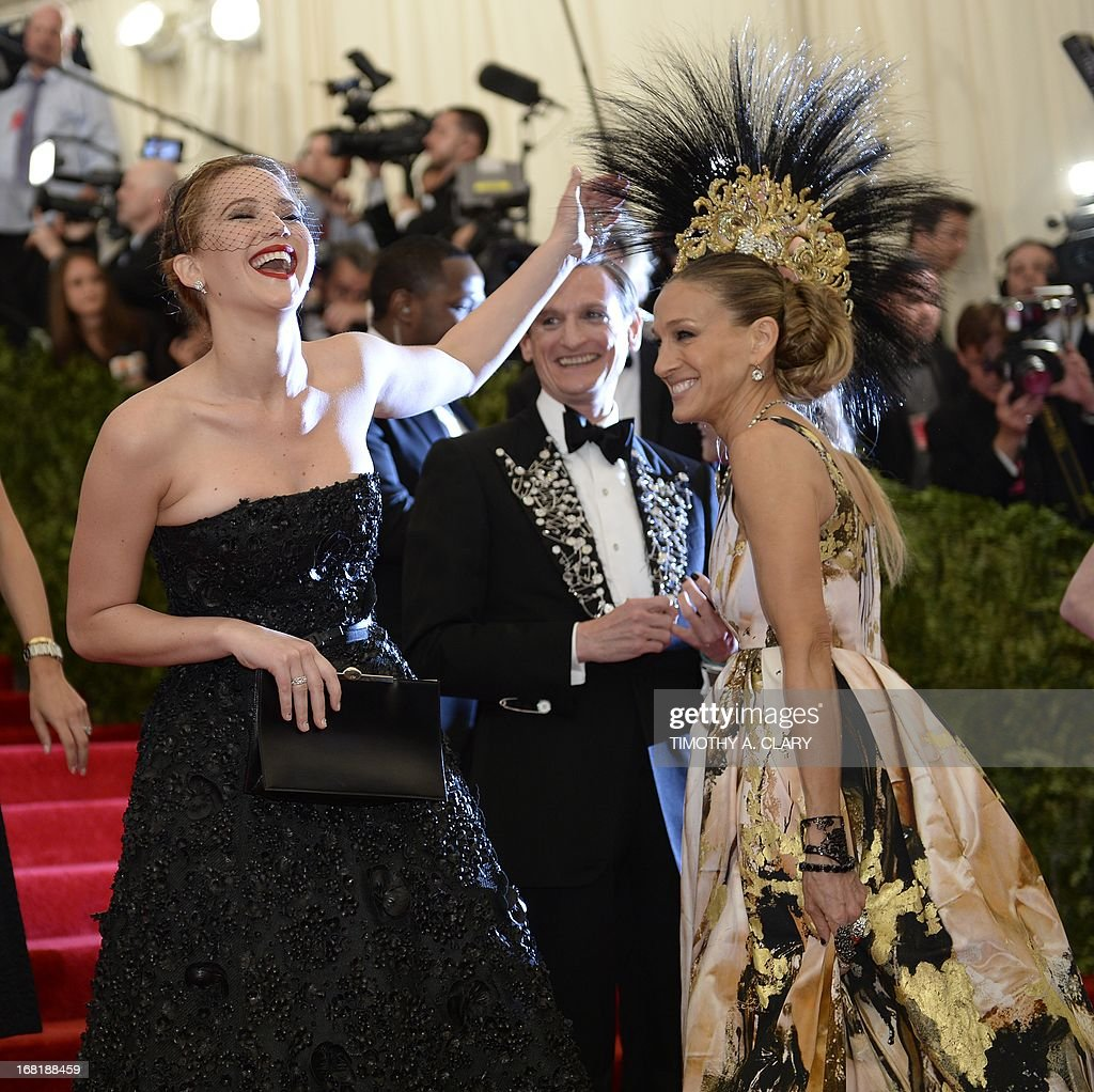 "Actresses Jennifer Lawrence (L) and Sarah Jessica Parker (R) arrive at the Metropolitan Museum of Art's Costume Institute Gala benefit in honor of the museum's latest exhibit, ""Punk: Chaos to Couture"" on May 6, 2013 in New York. AFP PHOTO/Timothy A. CLARY"